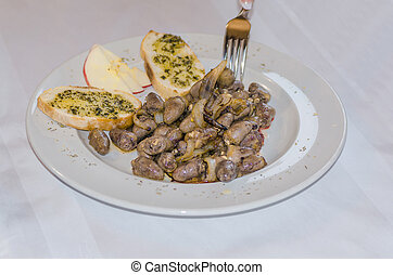 Chicken Hearts - Piquant fried chicken hearts with onions...