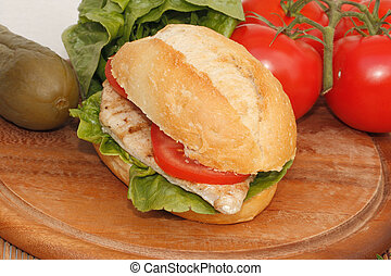 Chicken in a bun - Chicken with Salad and tomato in a bun