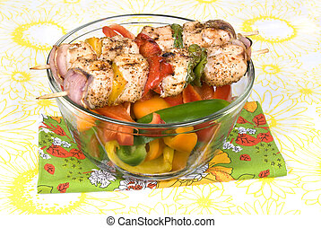 Chicken kebob skewers with bell peppers