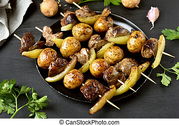 Chicken liver and vegetables on skewers