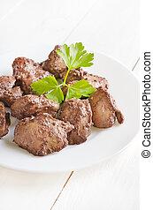 Chicken liver on white plate