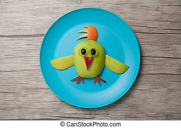 Chicken made with apple on plate and table