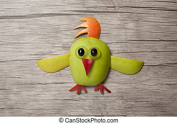 Chicken made with apple on wooden background