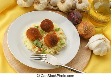 chicken meat balls with organic rice on a plate