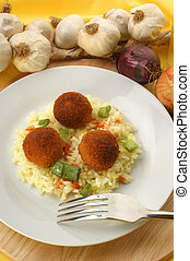 chicken meat balls with rice on a plate