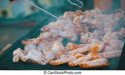 Chicken Meat Cooking on a Barbecue Grill. Slow Motion