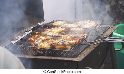 Chicken Meat Cooking on a Barbecue Grill in Slow Motion -...