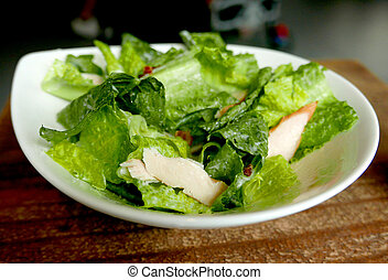 Chicken, meat, lettuce delicious ceasar salad in the white dish