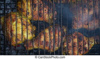 chicken meat on a barbecue grill