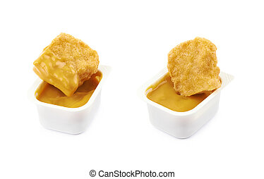 Chicken nugget composition isolated - Chicken nugget in a...