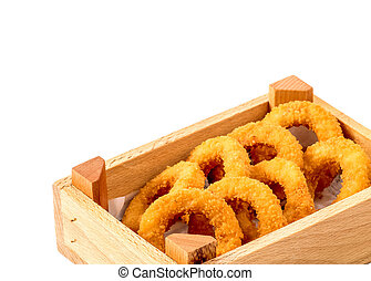chicken nugget round shape in a wooden box on a white...