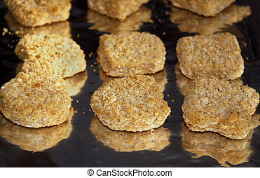 Chicken Nuggets - Frozen chicken nuggets on foil ready for ...