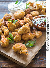 Chicken nuggets - Homemade fried chicken nuggets on wooden ...