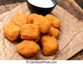 nuggets - Chicken nuggets with garlic sauce on old wooden ...