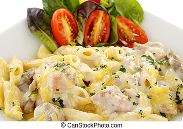 Delicious creamy chicken penne pasta with a garden salad.