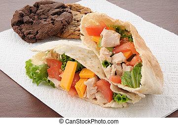 Chicken pita sandwich with cookies - a chicken pita sandwich...