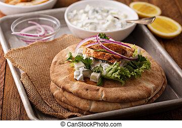 Chicken pita sandwich with cucumber sauce - Chicken pita...