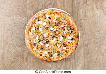 chicken pizza with vegetables on a wooden background