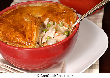 A chicken pot pie with flaky pastry crust