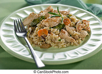 chicken risotto with asparagus mushroom and carrot close up