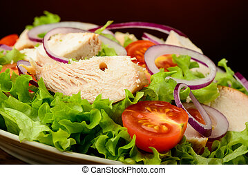 chicken salad and fresh vegetables