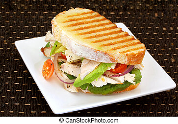 chicken Sandwich - Toasted sandwich with chicken, avocado,...