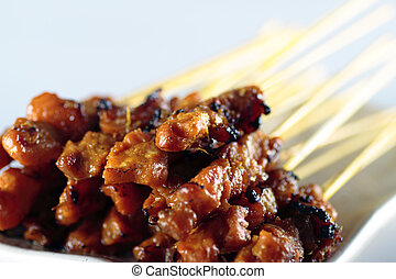 Chicken Satay - Close-up of a plate of chicken satay on...