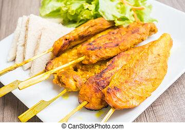 Chicken satay - Grilled Chicken satay in white plate