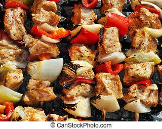 Chicken skewers BBQ - Closeup of chicken skewers on BBQ