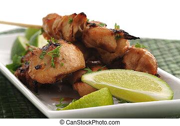 Chicken Skewers - Tasty grilled chicken satay with fresh...