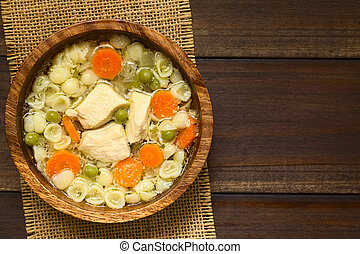 Chicken Soup - Homemade chicken soup with pea, carrot and...