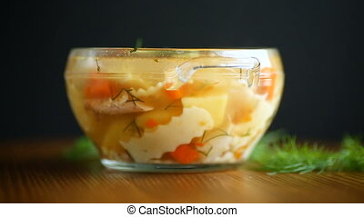 chicken soup with homemade noodles in a plate