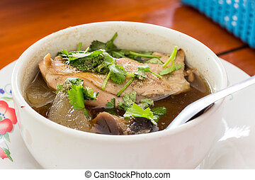 Chicken soup with Pickled lemon in cup. Thai food
