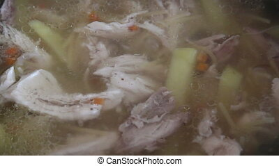 Chicken soup with potatoes cooked in a pan