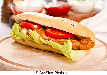Chicken sub on a wooden board