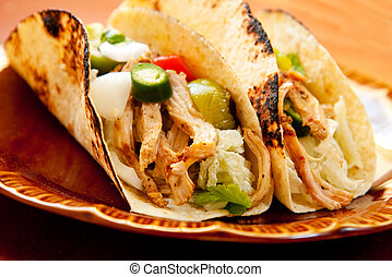 shredded chicken tight accompany cabbage and a chunky salsa verde