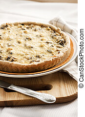 Chicken tart with mushrooms and cheese on a plate