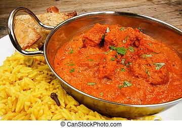 Chicken tikka masala in balti dish with rice - Chicken Tikka...