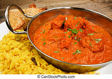 Chicken tikka masala in balti dish with rice - Chicken Tikka...