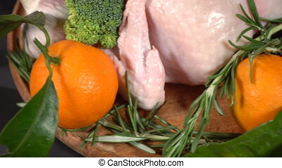 Chicken whole with tangerines on the table - Whole chicken...