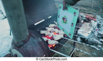 chicken wings are cooked in the grill and at the same time...