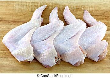 Chicken wings on a wooden board