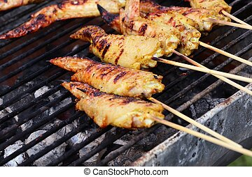 Chicken wings on barbecue grill