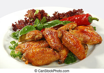 chicken wings - fried chicken wings in friture with red...