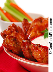 Chicken wings with dipping sauce - Hot and spicy chicken...