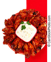 Hot and spicy chicken wings with blue cheese dipping sauce