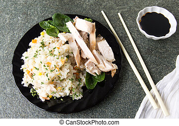 Chicken with rice and vegetables on a plate