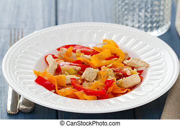 chicken with vegetables on white plate