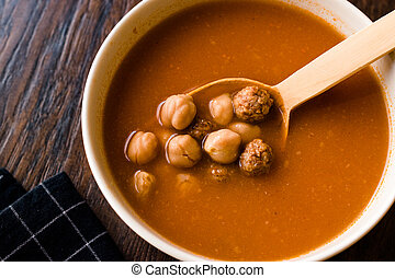 Chickpea Soup Stew with Meatballs and Wooden Spoon / Spanish Potaje de Garbanzos