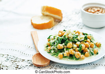 chickpeas and spinach curry on a white background. the ...